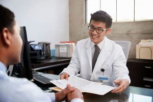 happy-asian-male-doctor-in-consultation-with-male